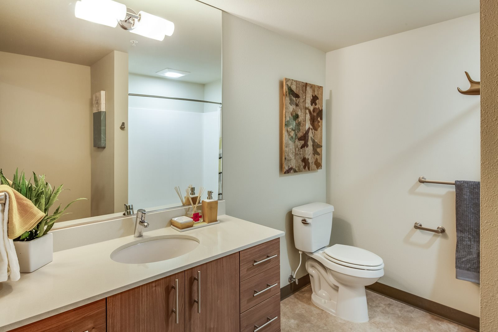 Designer Bathrooms with Frameless Mirrors at Platform 14, 1030 NE Orenco Station Pkwy, Hillsboro