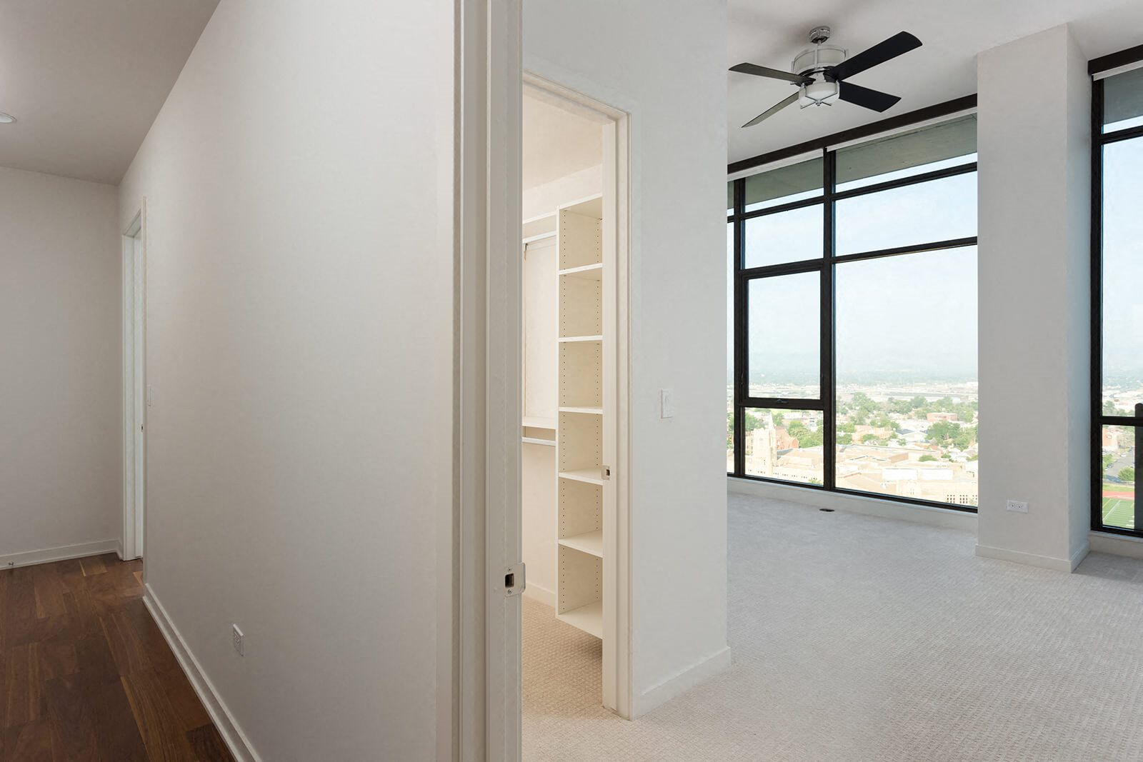 Walk-In Closets with Built-In Shelving at 1000 Speer by Windsor, 1000 Speer Blvd., Denver