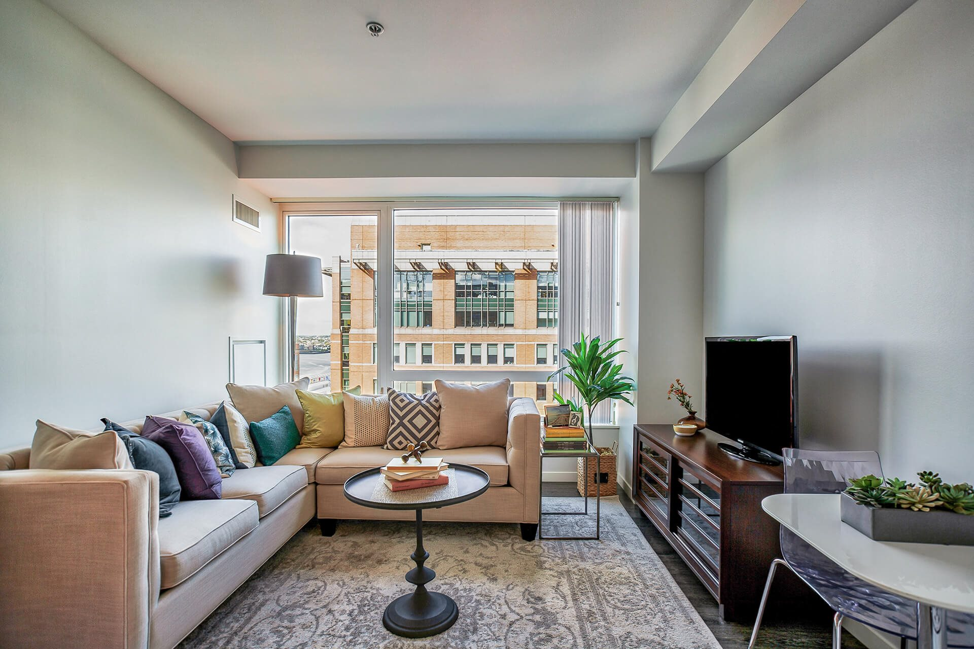 Spacious living room at Waterside Place by Windsor, 02210, MA