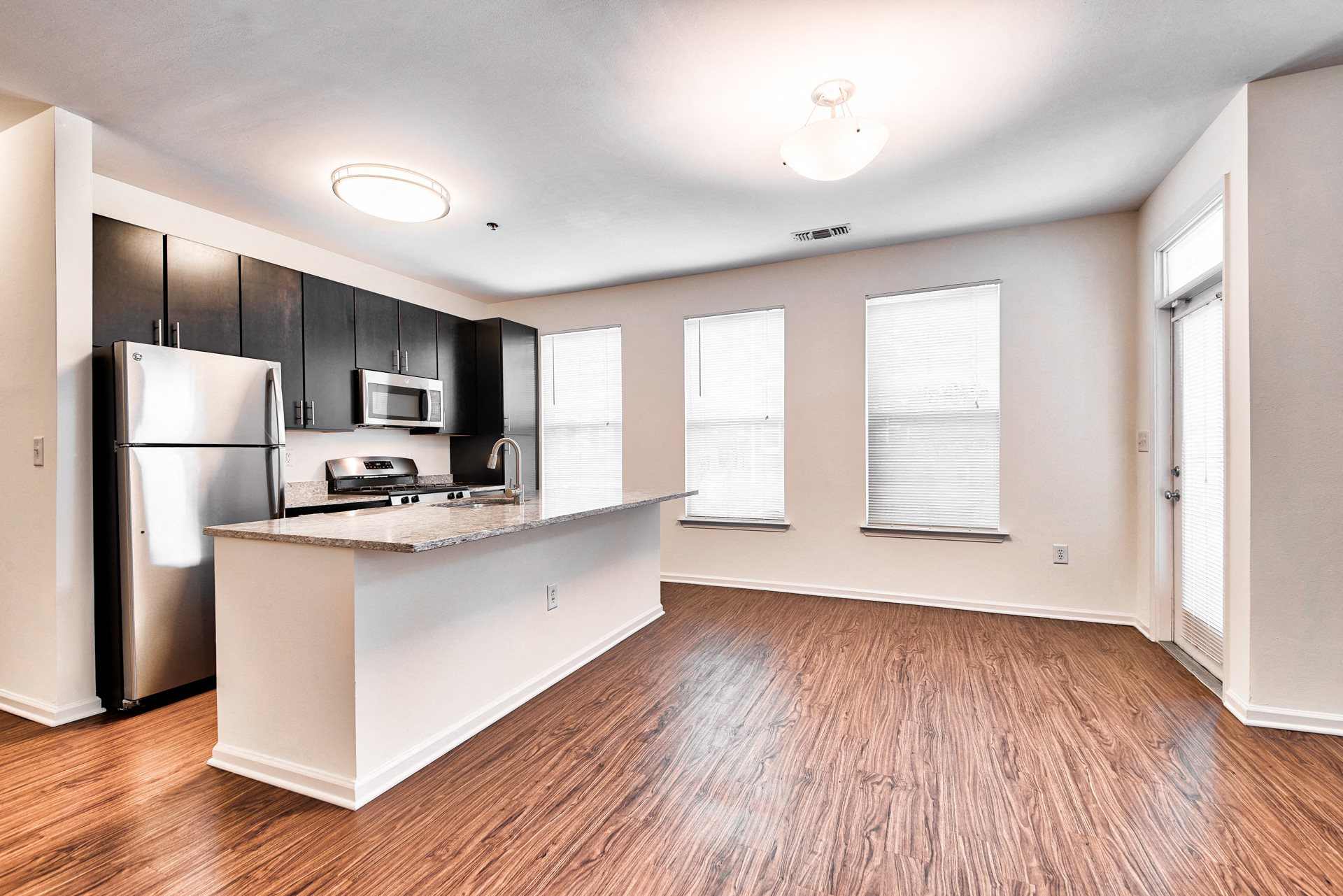Open layouts with black walnut vinyl flooring at Windsor at Liberty House, 115 Morris Street, Jersey City