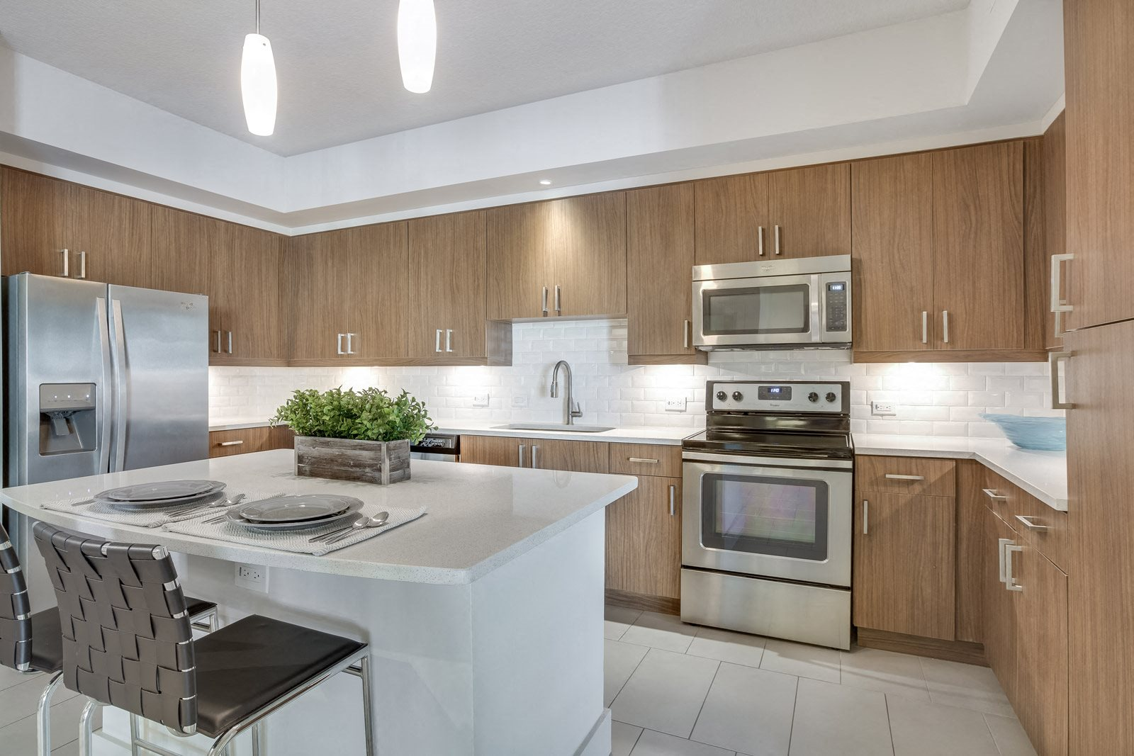 Chef-Inspired Kitchens with Quartz Counters and Stainless Steel Appliances at Windsor at Doral, 4401 NW 87th Avenue, Doral