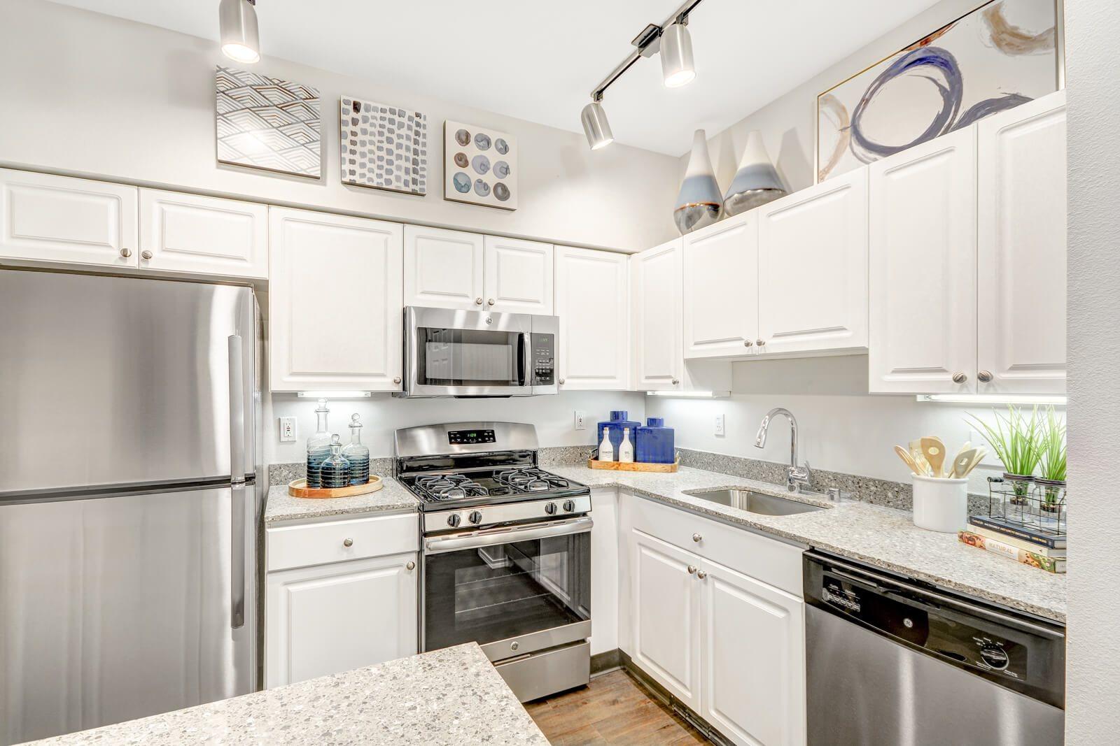 Renovated Kitchen with Quartz Countertops at The Estates at Cougar Mountain, 2128 Shy Bear Way NW, WA