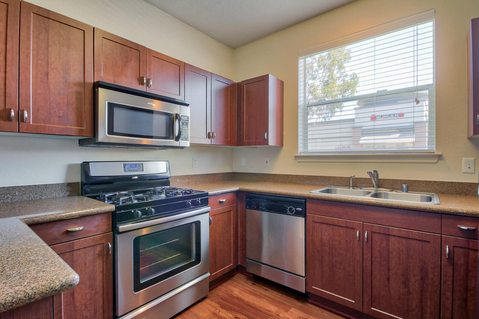 Upscale Kitchens with Granite Countertops, Cherry Oak Cabinets, and Stainless Steel Appliances at Windsor at Main Place, Orange, CA