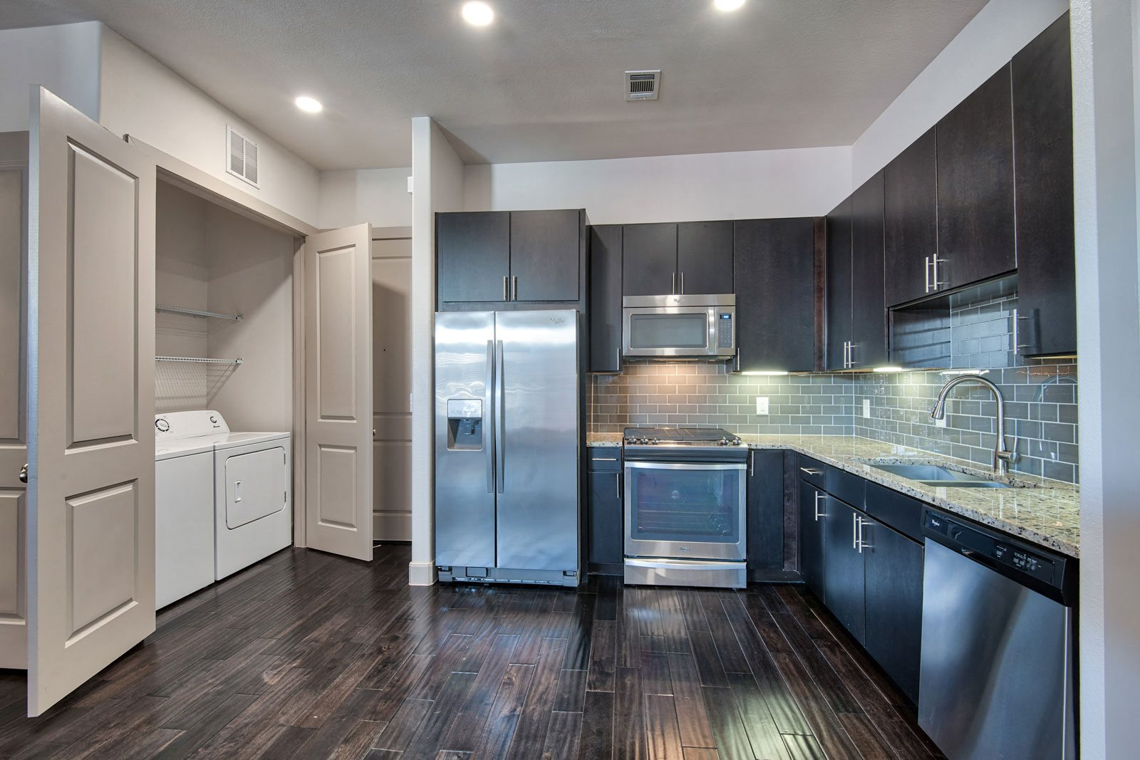 Gourmet Kitchen with Stainless Steel Appliances at Midtown Houston by Windsor, Houston, TX