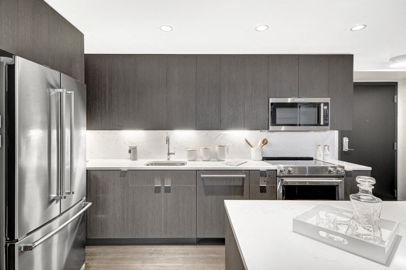 Fully-Equipped Kitchen with Stainless Steel Appliances at Stratus, Seattle, 98121
