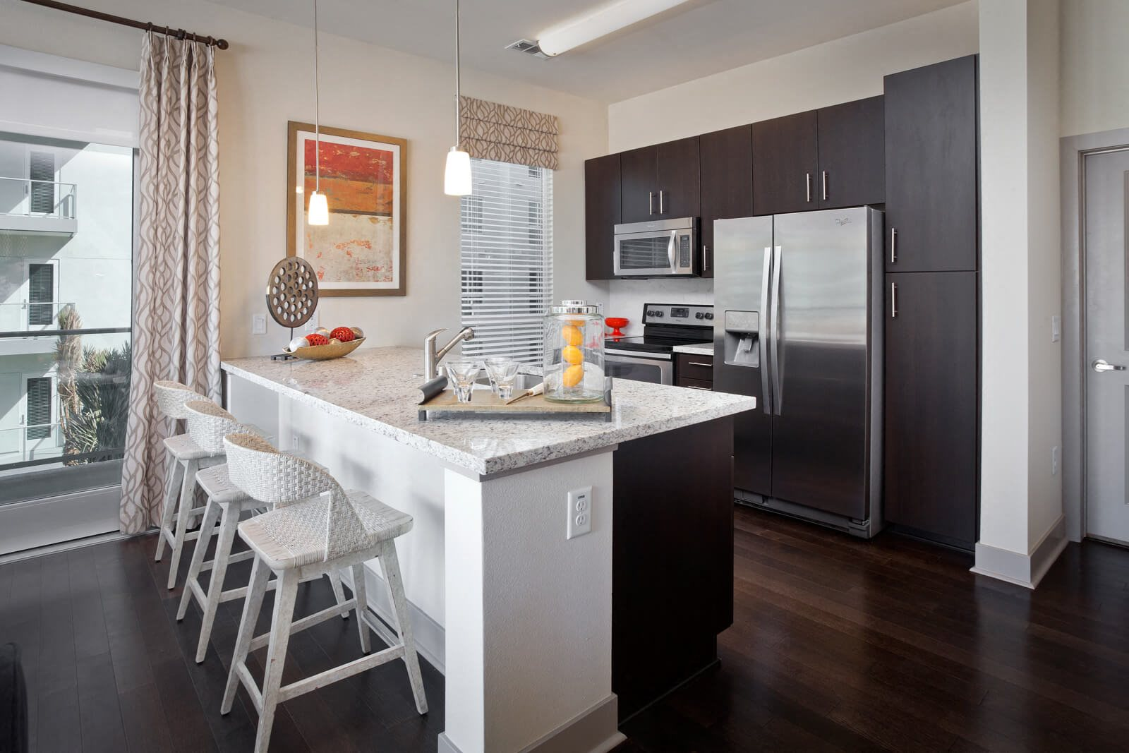 Open-Concept Kitchens with Stainless Steel Appliances at South Park by Windsor, 939 South Hill Street, CA