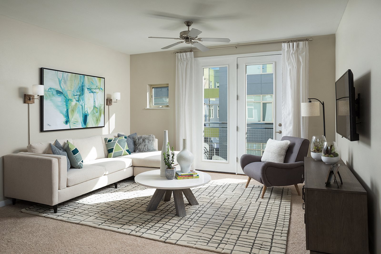 Bright living spaces with ceiling fans at The District, 80222