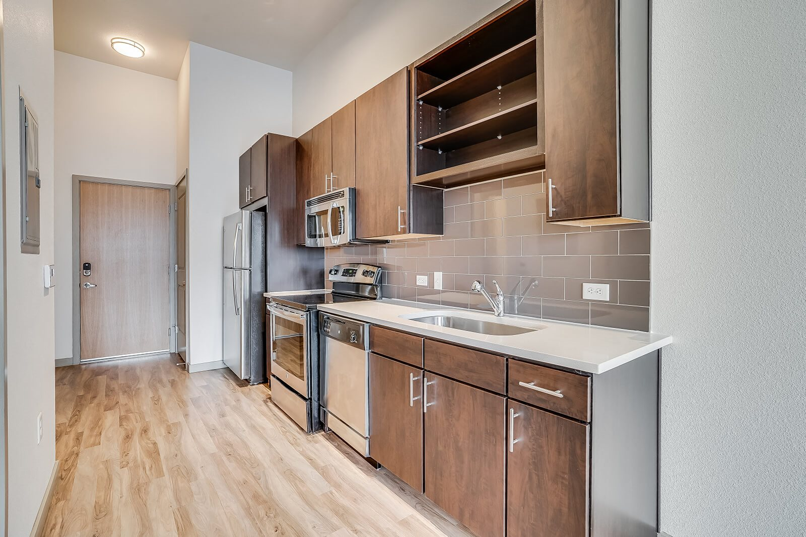 Stainless Steel Appliances and Backsplashes in Kitchen at The Casey, Denver, CO