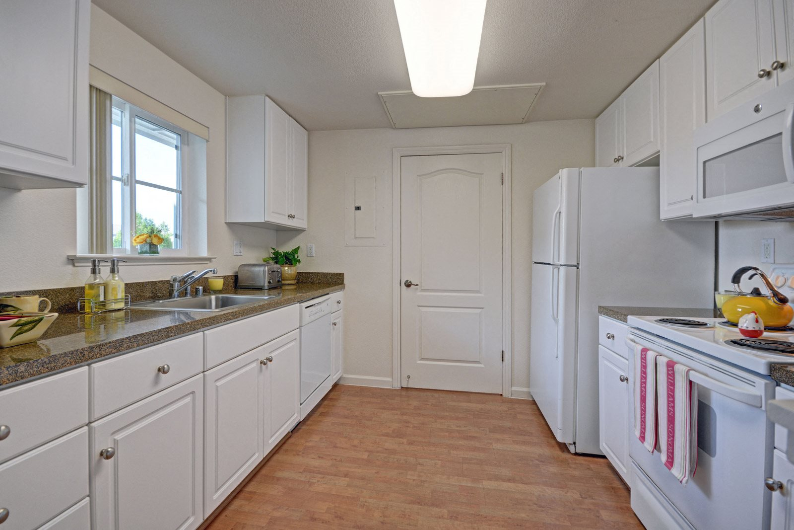 Wood Flooring in Kitchen at The Kensington, 1552 East Gate Way, #126, CA