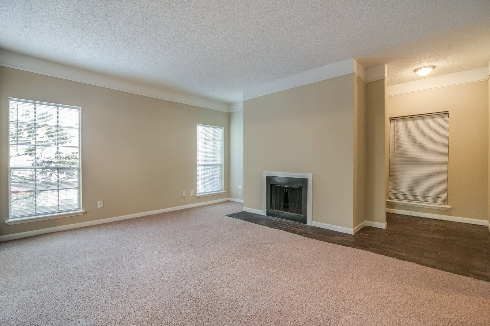 Living Room with Fireplace at Allen House Apartments, 77019, Texas