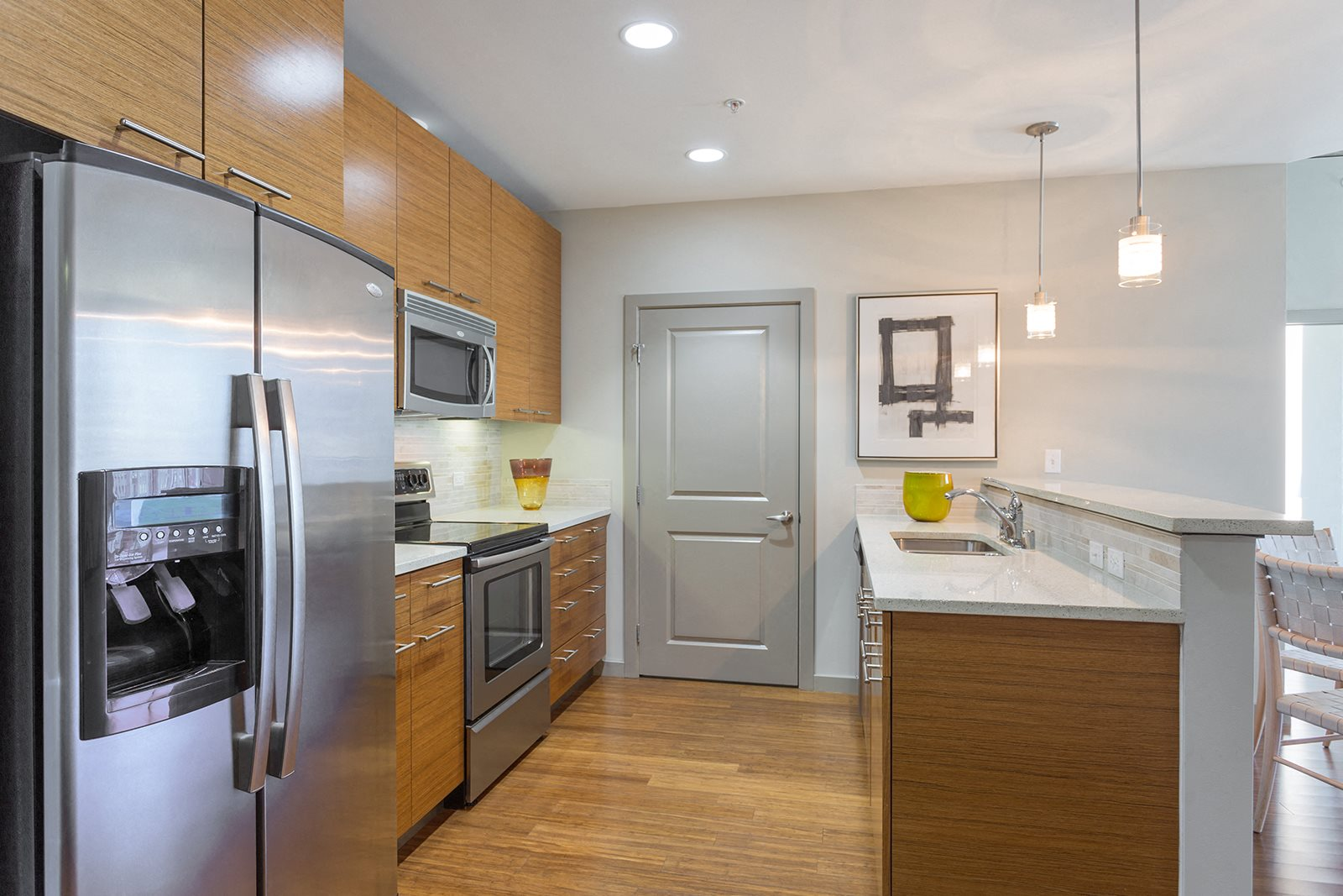 Modern Kitchens with Stainless Steel Appliances at Glass House by Windsor, 75201, TX