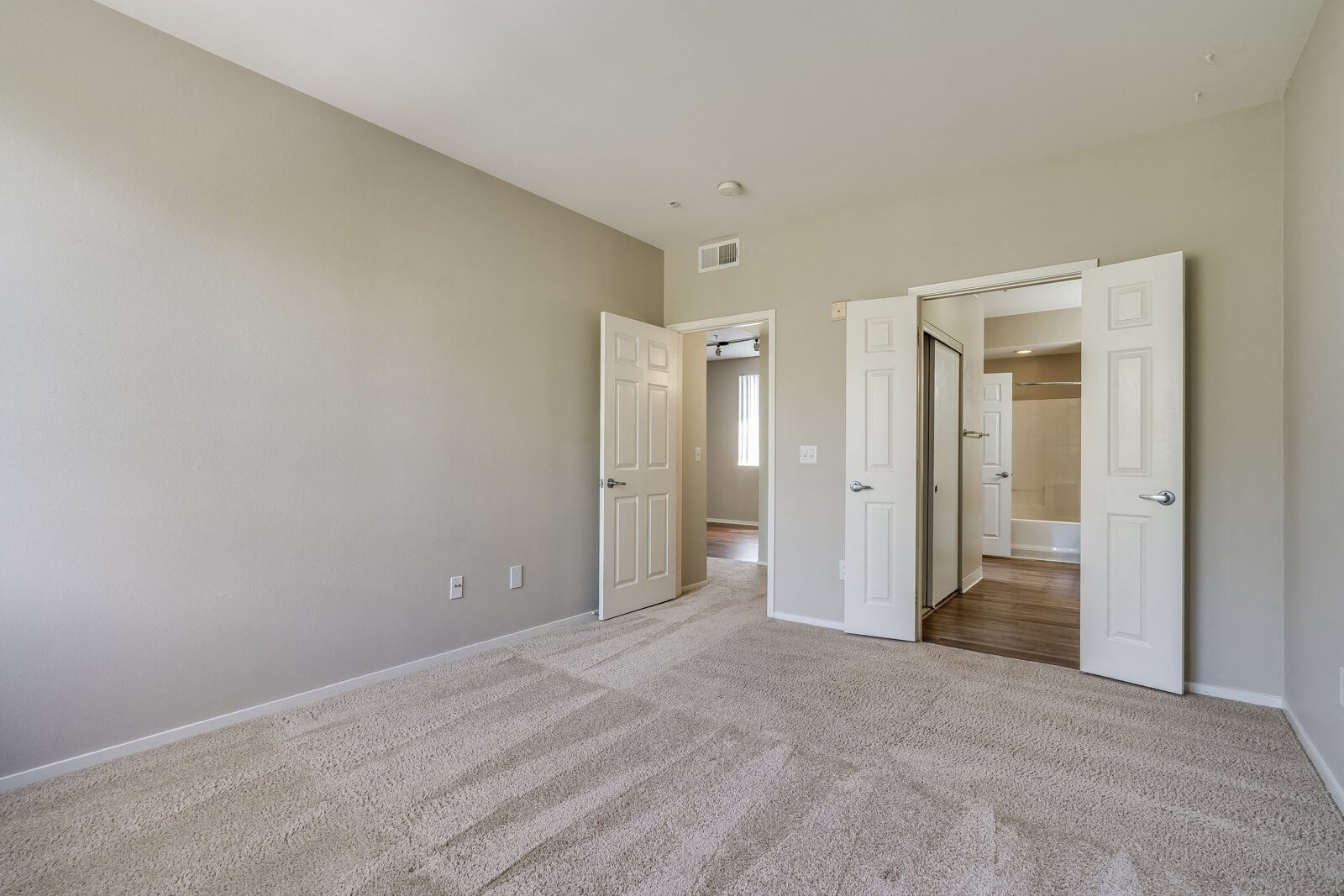Wall-To-Wall Carpeting in Spacious Bedroom at Pavona Apartments, San Jose, CA