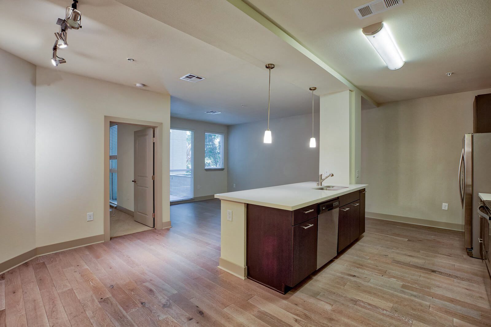 Wood-Style Flooring in Entry, Kitchen, Living and Dining Areas at South Park by Windsor, 90015, CA