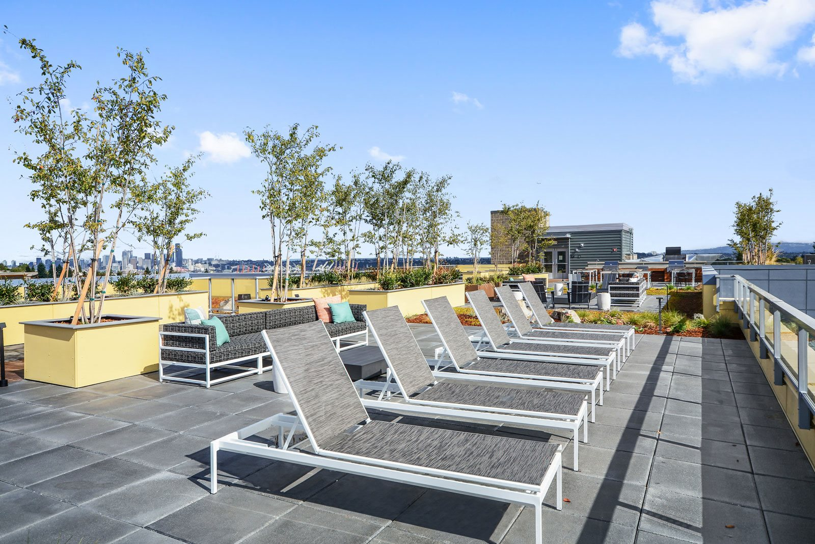 Rooftop Sundeck with Lounge Chairs at The Whittaker, 4755 Fauntleroy Way, Seattle