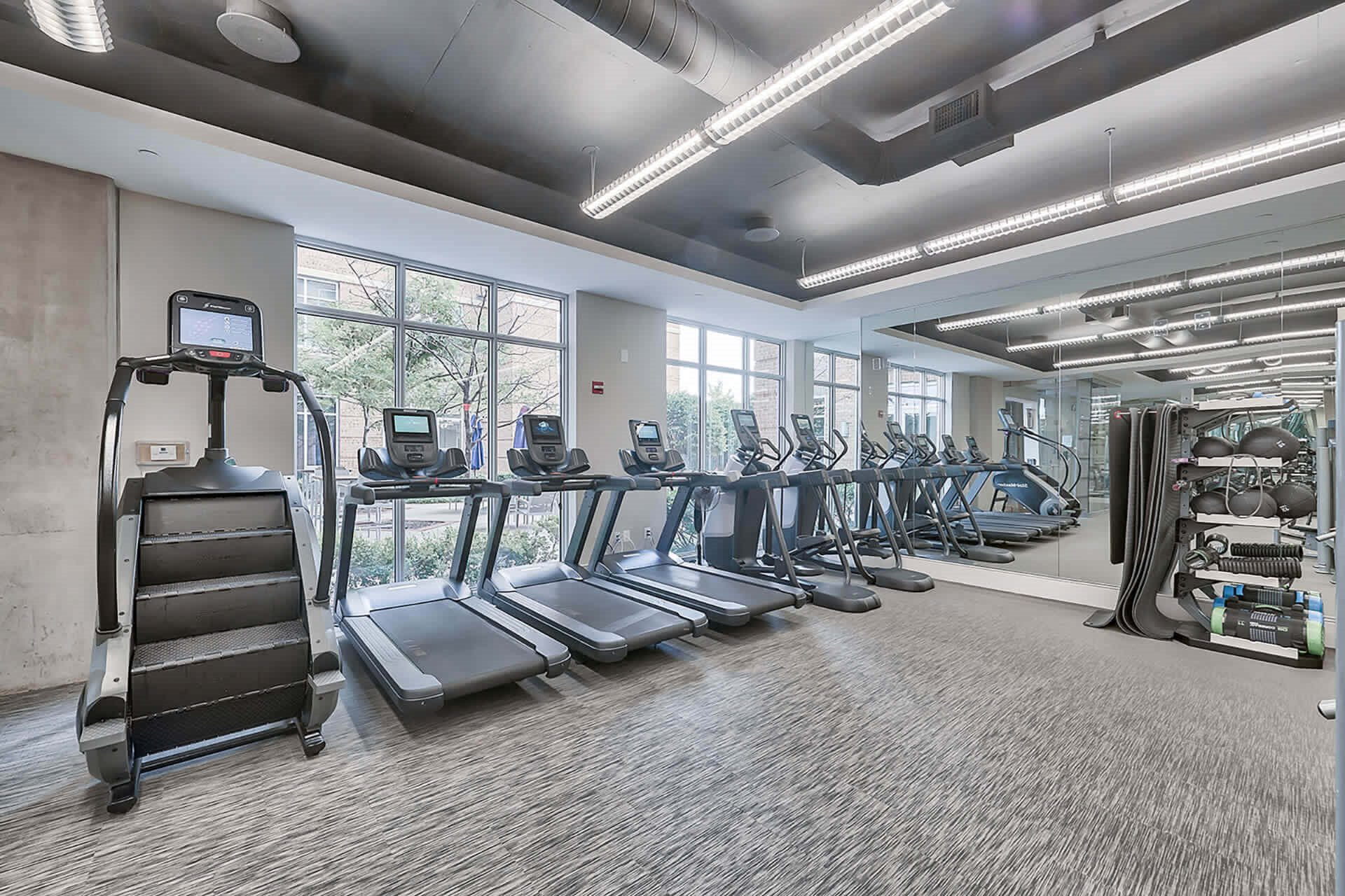 Cardio and weight training equipment at Crescent at Fells Point by Windsor, Baltimore, Maryland