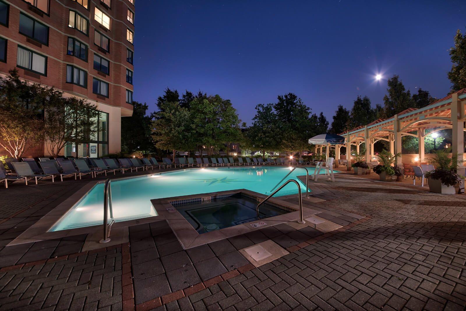 Sparkling Swimming Pool Lights Up at Night at Windsor at Mariners, Edgewater, NJ