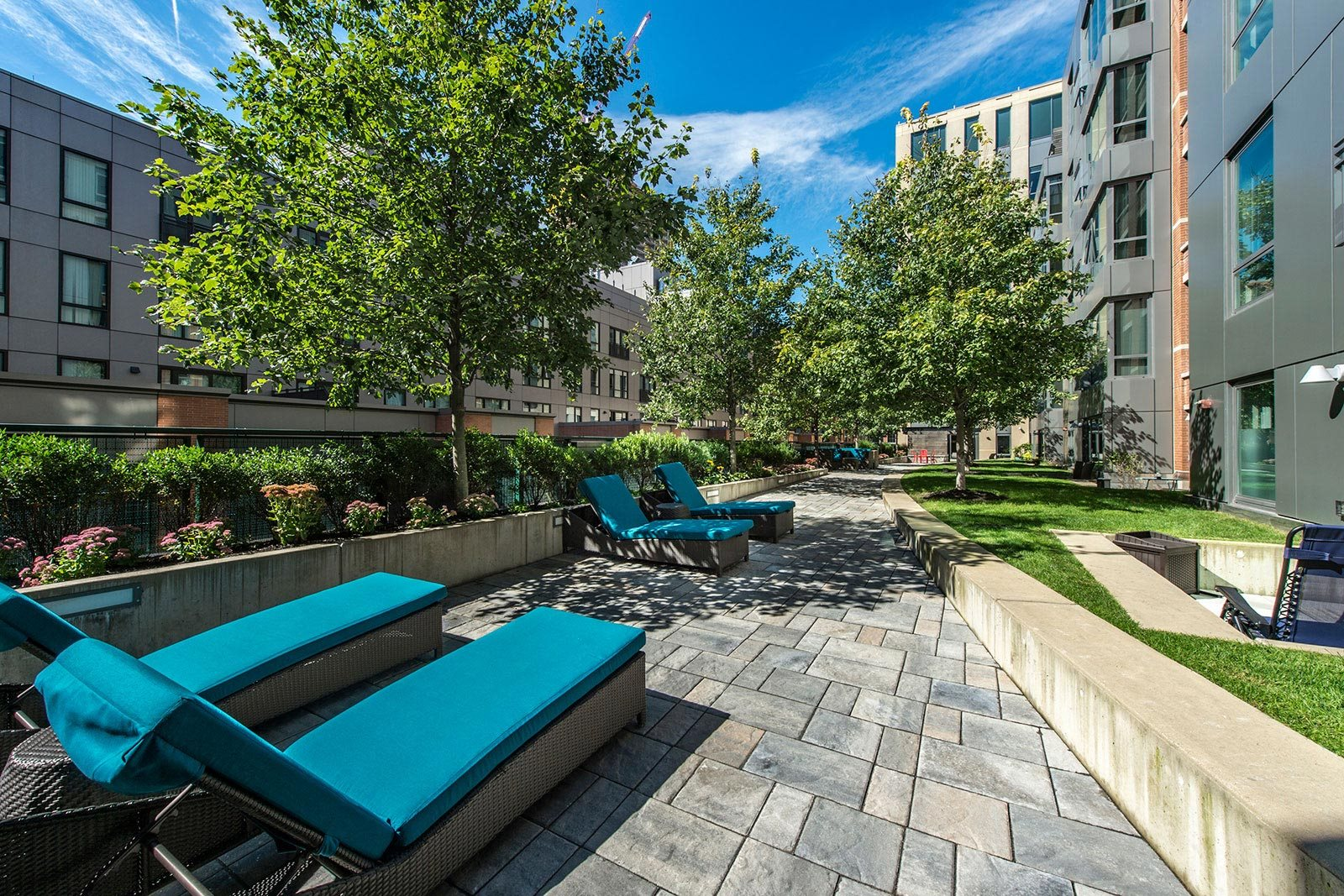 Garden Terrace with Lounge Chairs at The Victor by Windsor, Massachusetts, 02114
