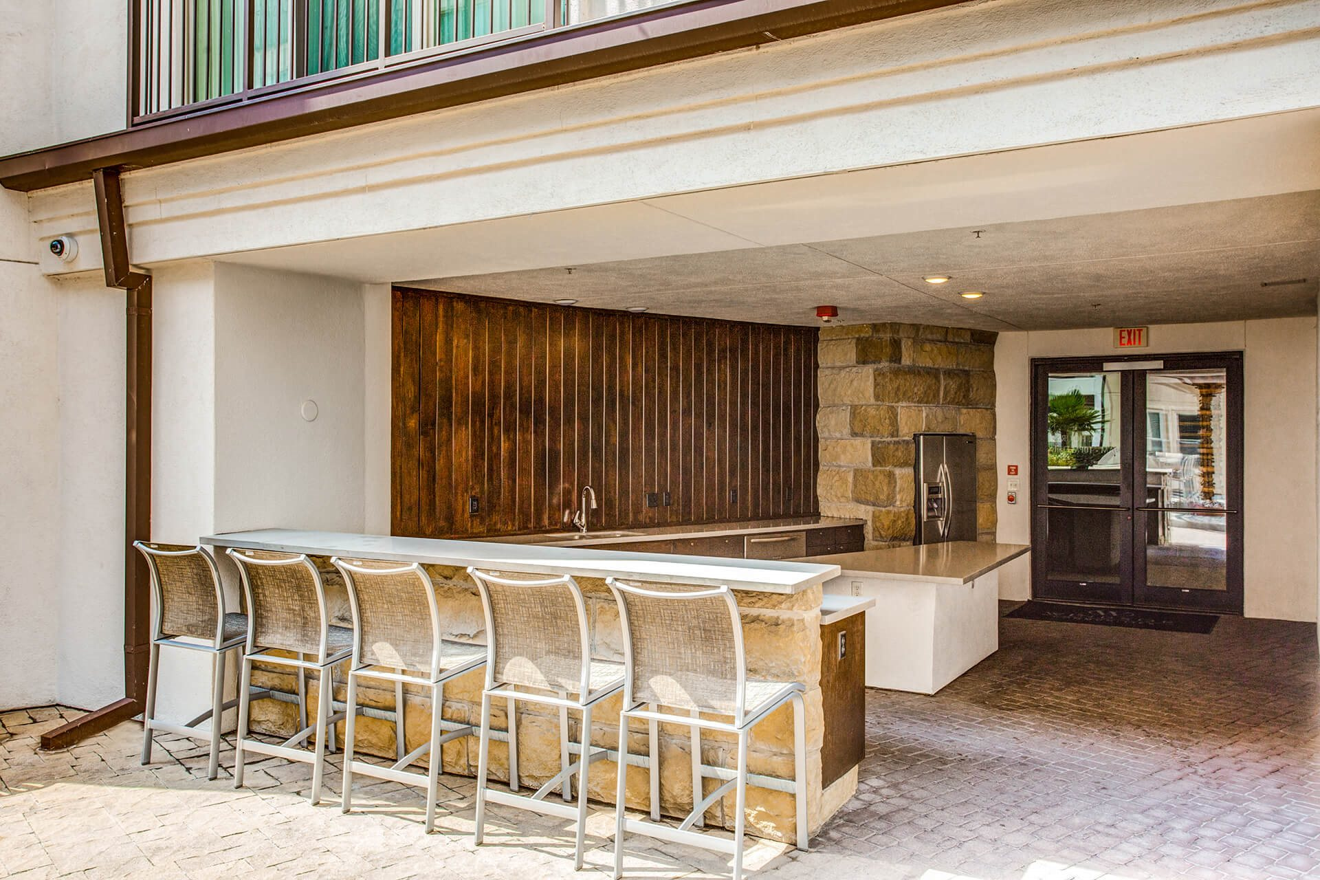 Open-concept, outdoor kitchen at The Monterey by Windsor, Dallas, TX