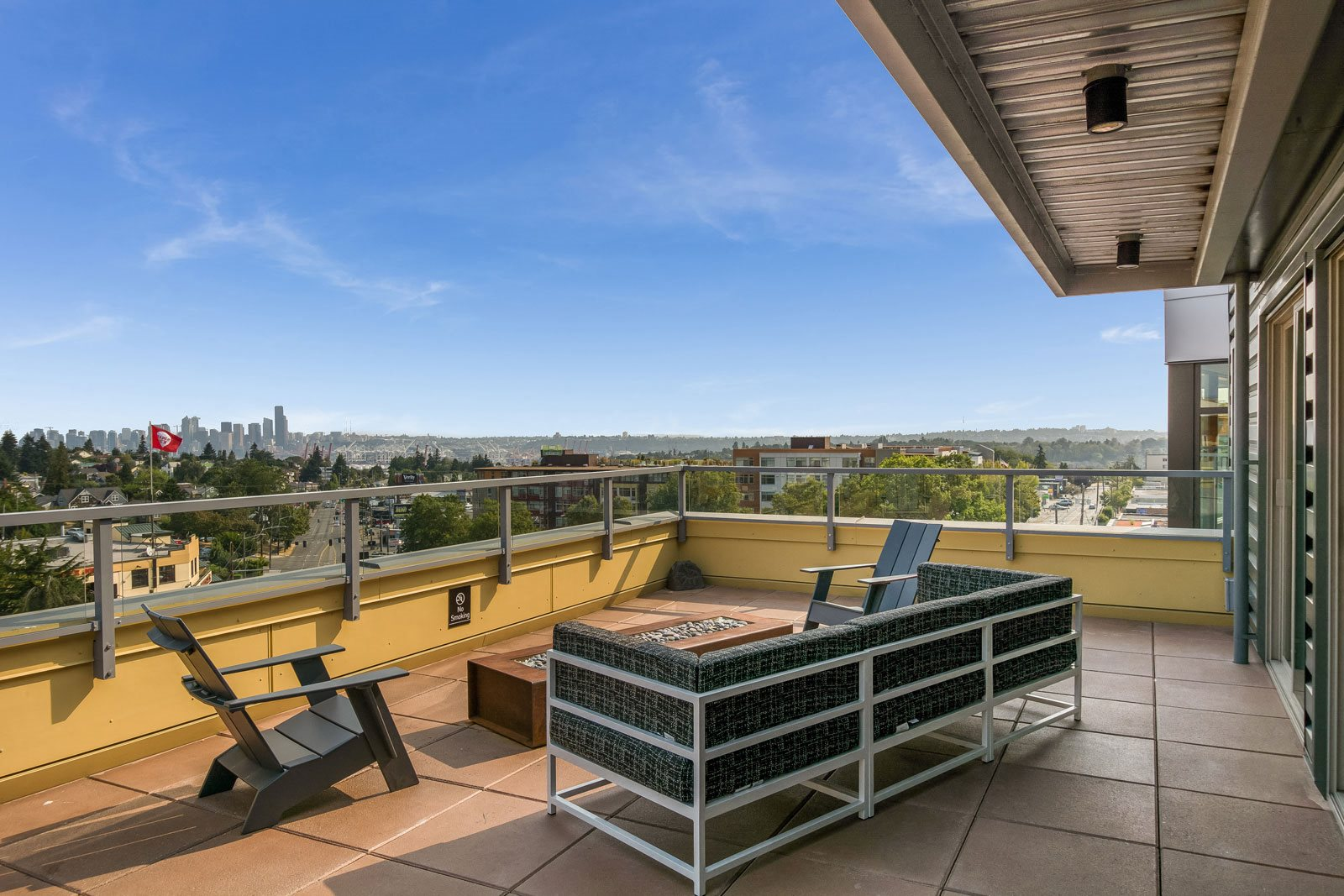 Relaxing Outdoor Lounge Area with Fire Pit at The Whittaker, 4755 Fauntleroy Way, Washington