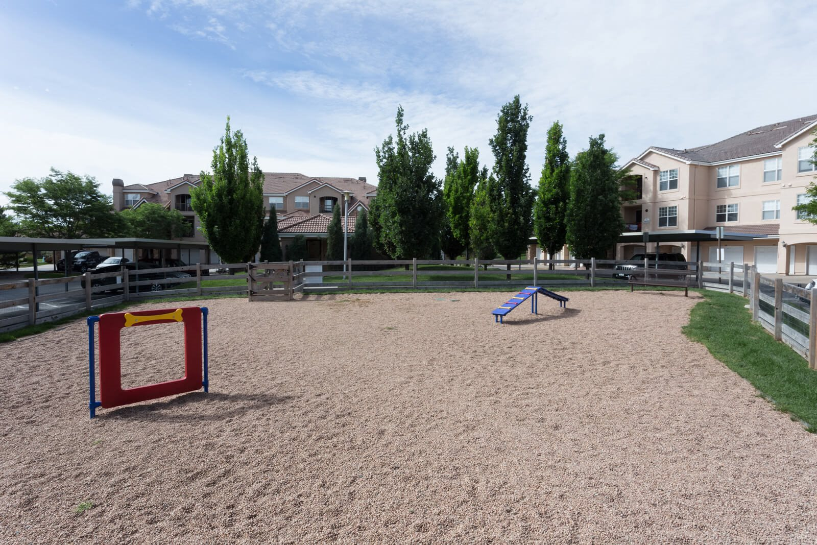 Dog Park with Sand, Grass, and Obstacles at Windsor at Meridian, Englewood, Colorado