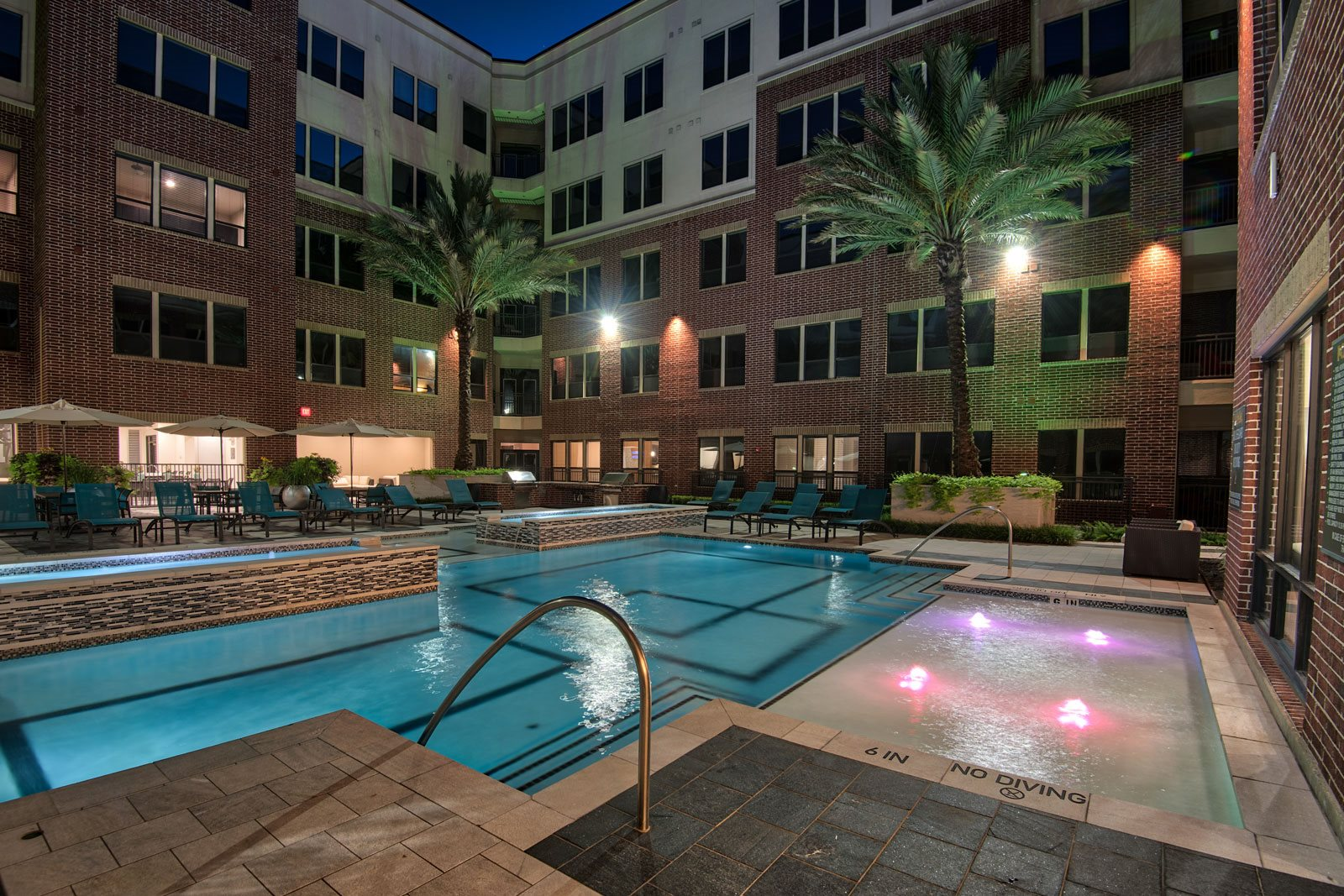 Pool lit up at night at Midtown Houston by Windsor, 2310 Main Street, Houston