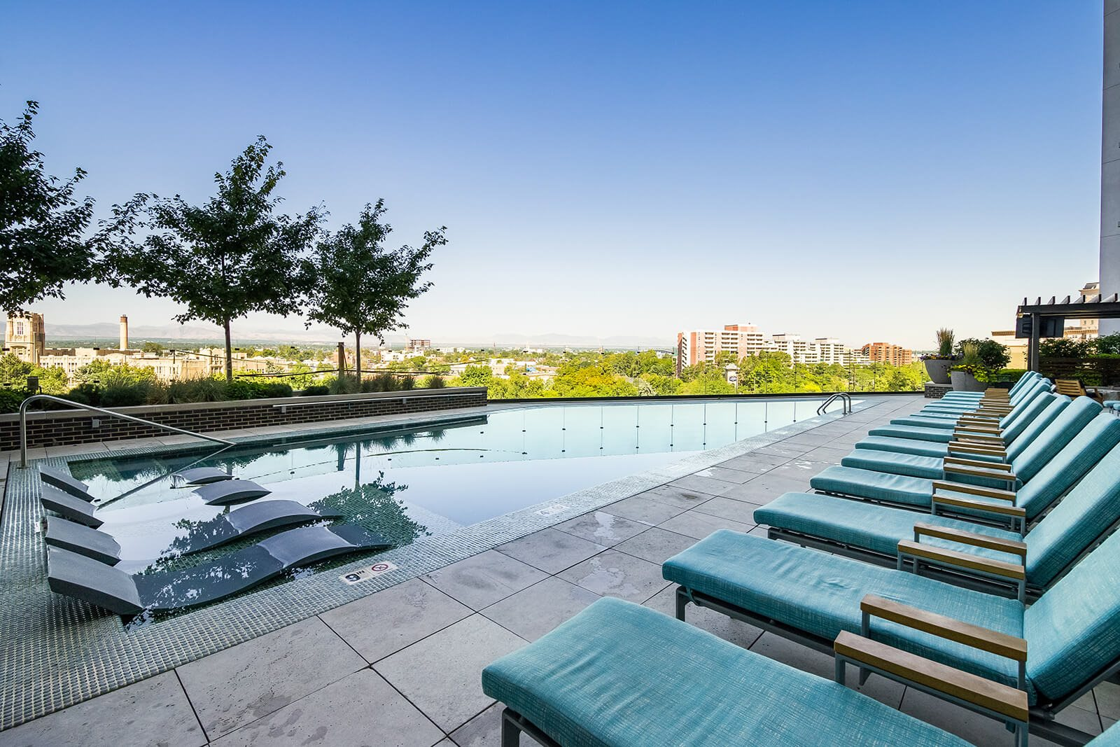 Resort-Style Pool with Sundeck and Lounge Chairs at 1000 Speer by Windsor, Denver, CO