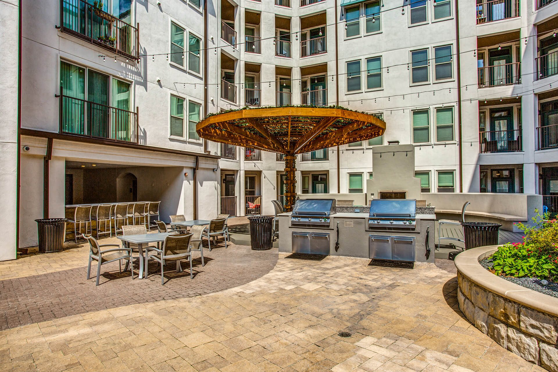 Outdoor grilling area at The Monterey by Windsor, Texas, 75240