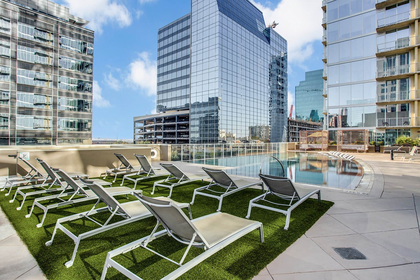 Swimming Pool with Sundeck and Lounge Chairs at Glass House by Windsor, 75201, TX