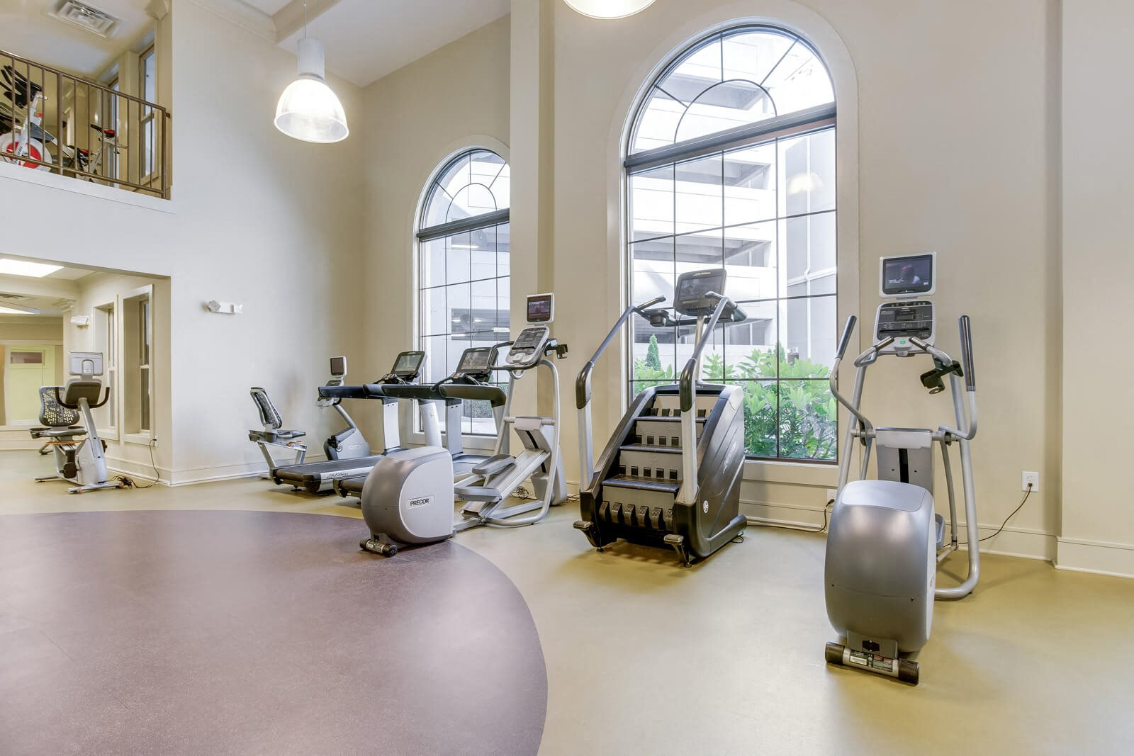 Cardio Equipment In Gym with Outdoor View at Windsor at Glenridge, 5610 Glenridge Drive, Sandy Springs