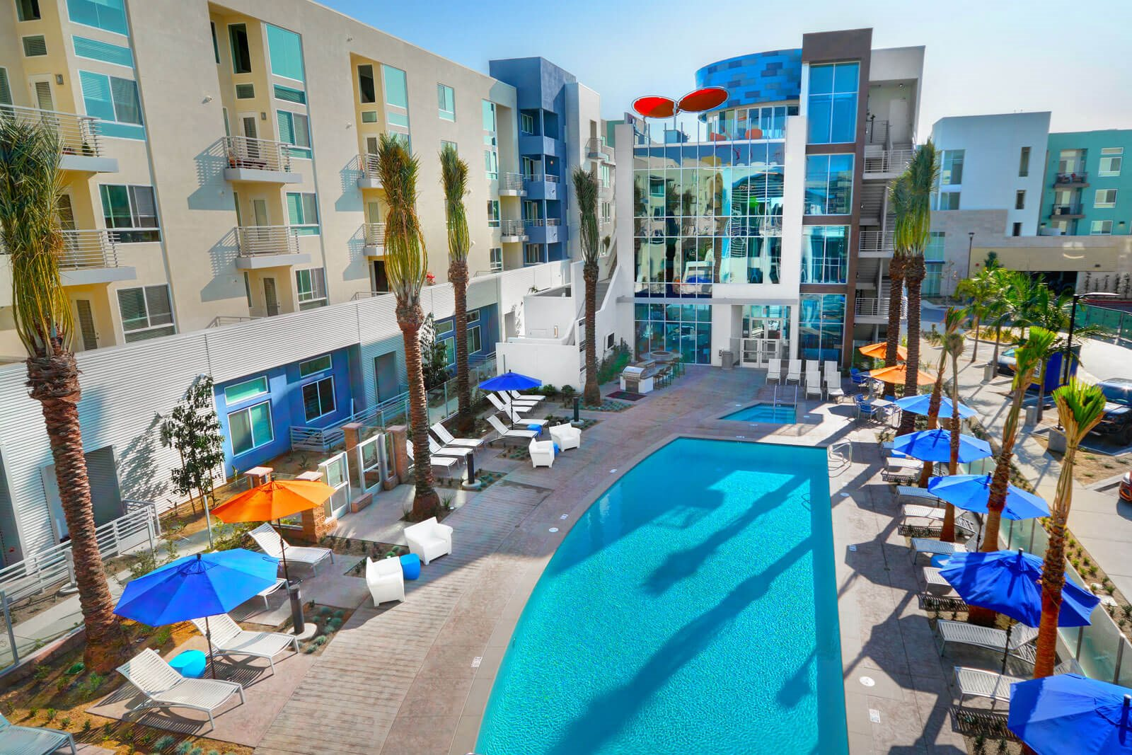 Sundeck with Lounge Chairs and Shade Umbrellas at Boardwalk by Windsor, 92647, CA