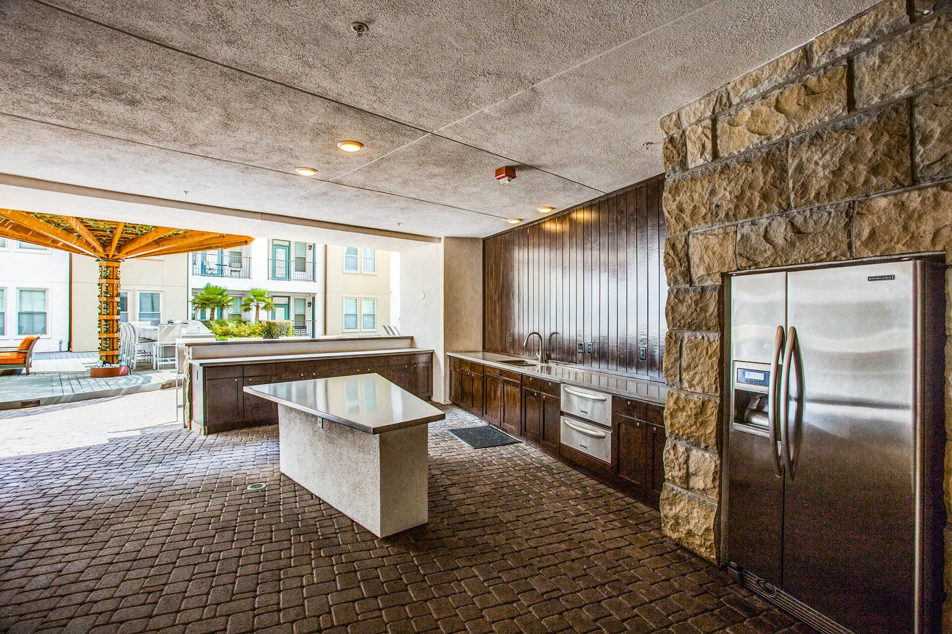 Fully-equipped outdoor kitchen at The Monterey by Windsor, Dallas, TX