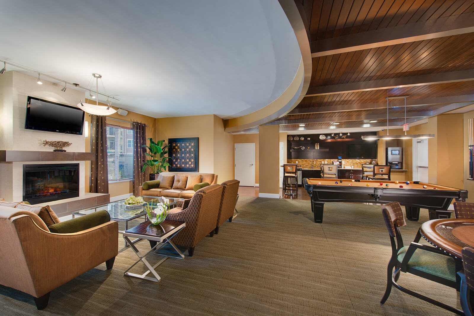 Large Clubroom With Fireplace at The Ridgewood by Windsor, Fairfax, VA