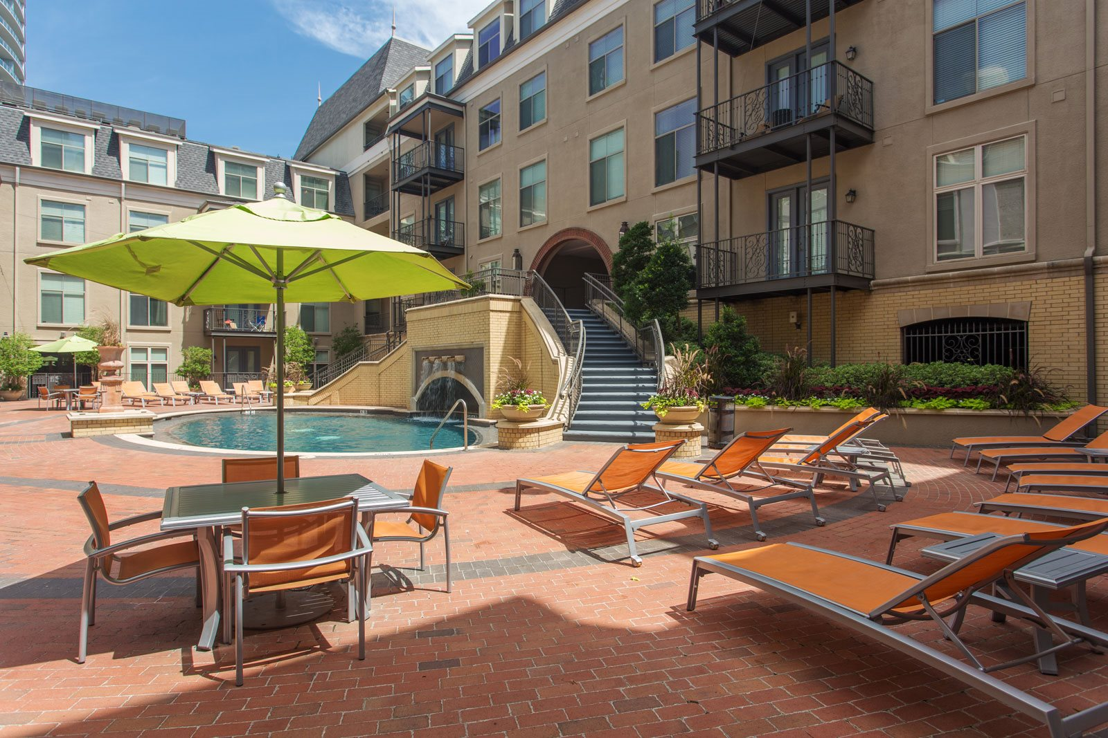 Pool with Sundeck and Lounge Chairs at Trianon by Windsor, 75201, Texas