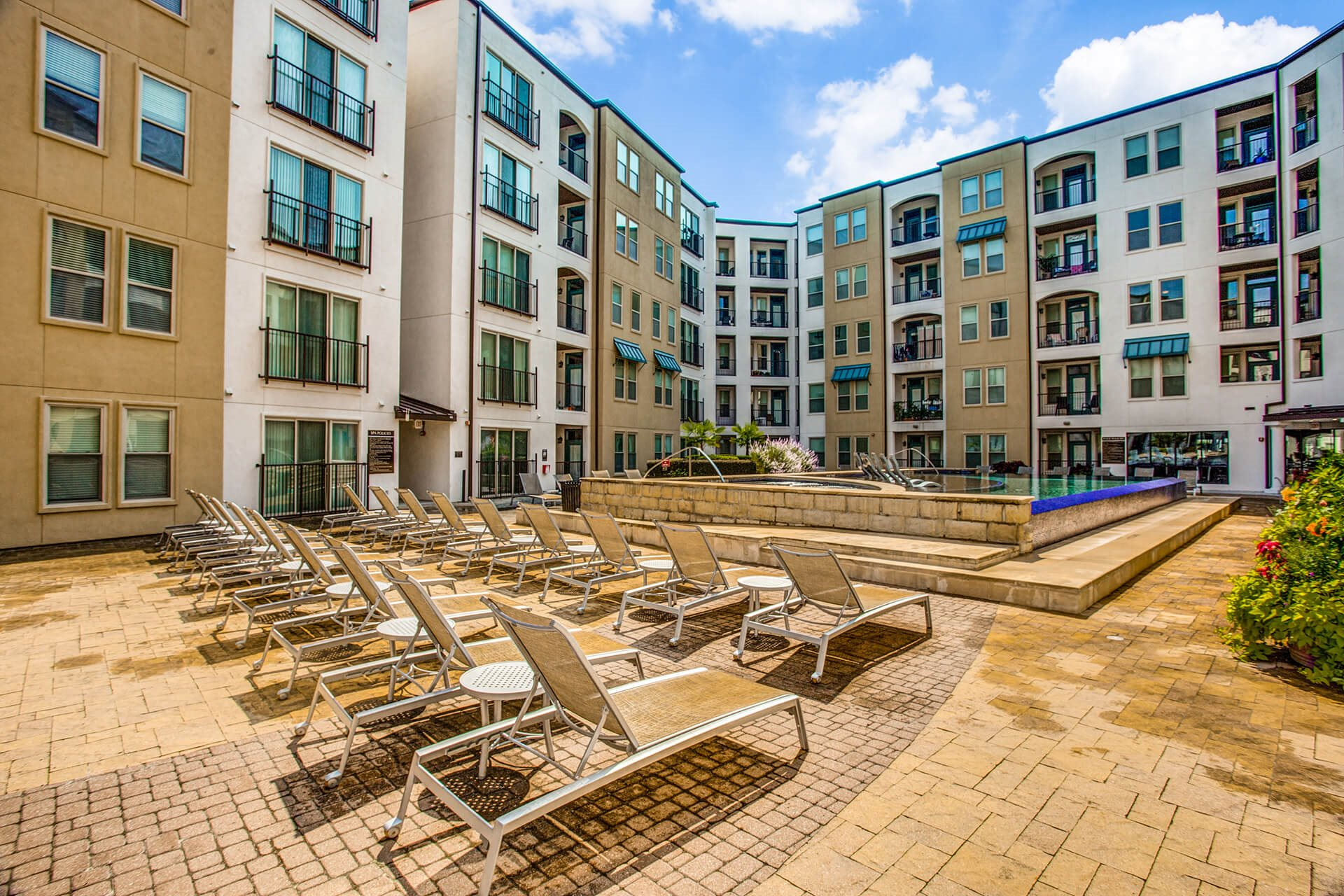 Sundeck around pool at The Monterey by Windsor, Texas, 75240