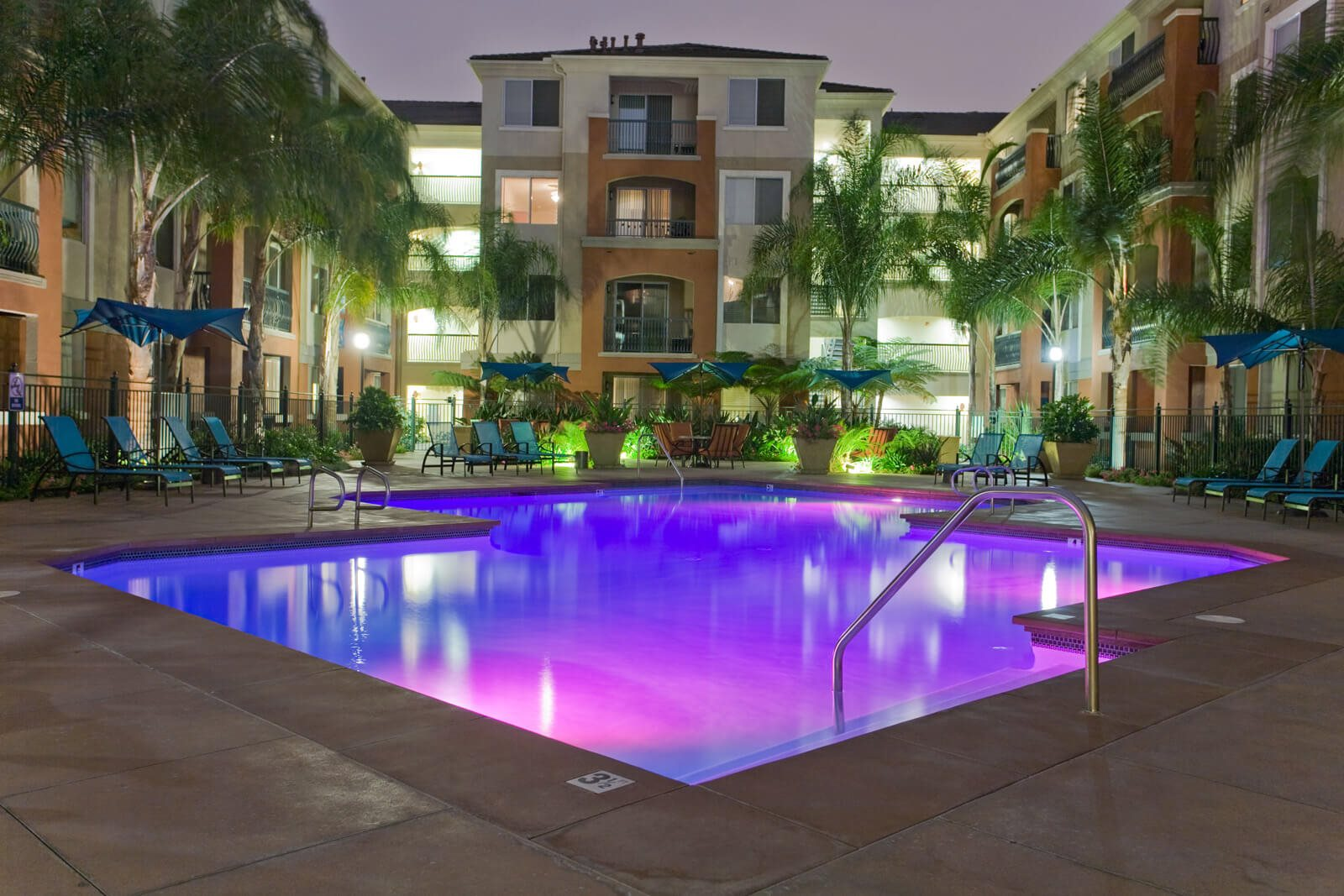 Pool Lighted at Night at Windsor at Main Place, Orange, CA