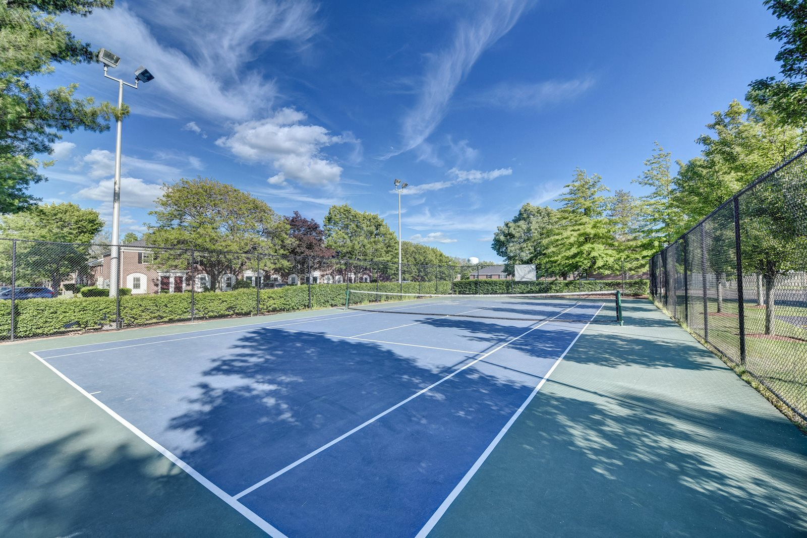 Lighted Regulation Tennis Court at Windsor Ridge at Westborough, Westborough, Massachusetts