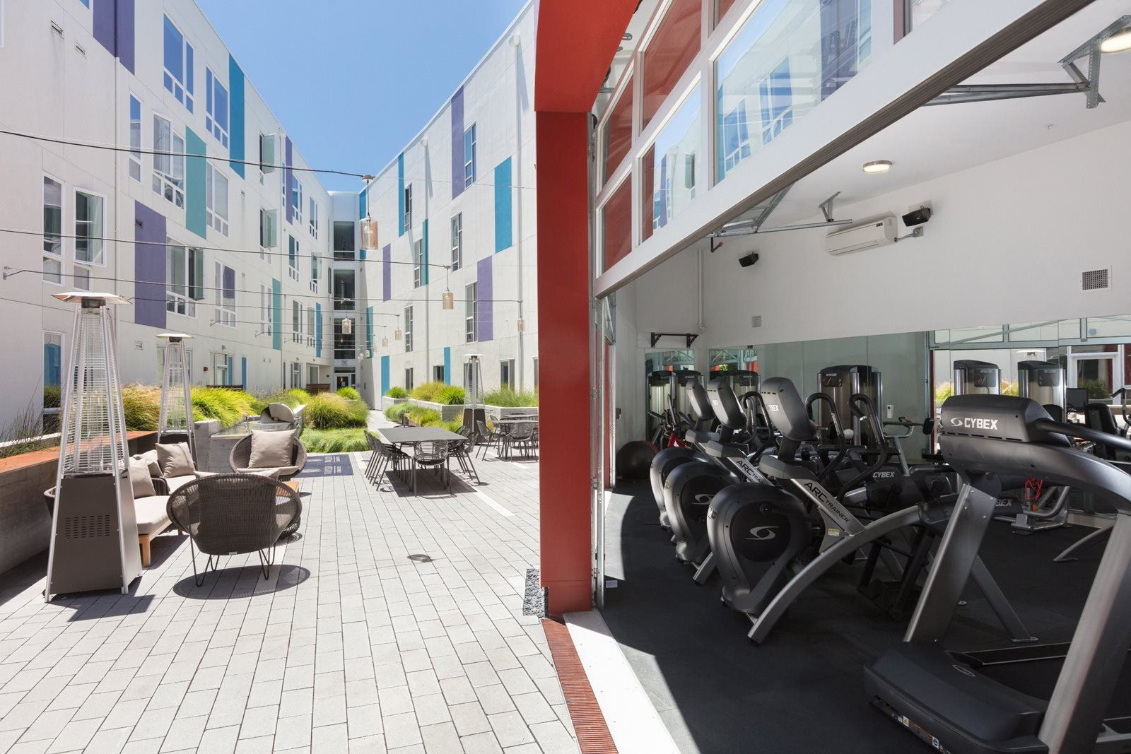 Fitness Center with Retractable Door for Fresh Air Workout at Mission Bay by Windsor, San Francisco, 94158
