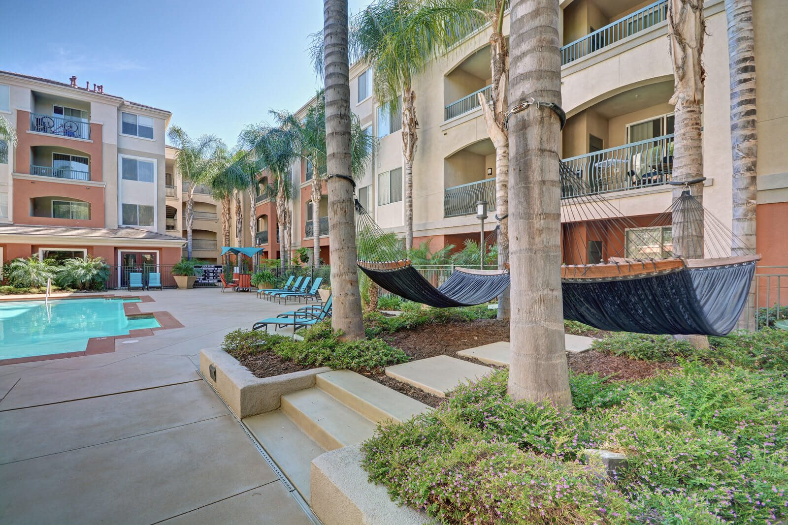 Pool Deck with Lounge Chairs and Hammocks at Windsor at Main Place, Orange, California
