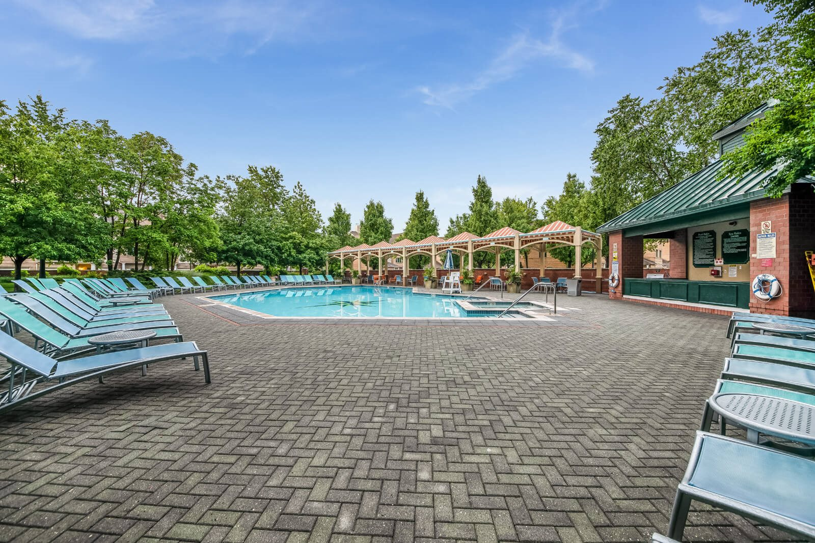 Pool with Sundeck and Lounge Chairs at Windsor at Mariners, Edgewater, NJ