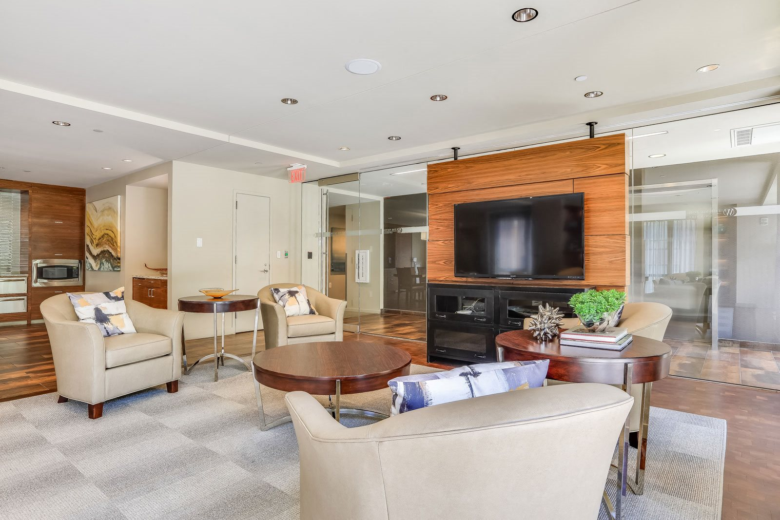 Resident Living Room with TV and Kitchen at The Victor by Windsor, Boston, 02114