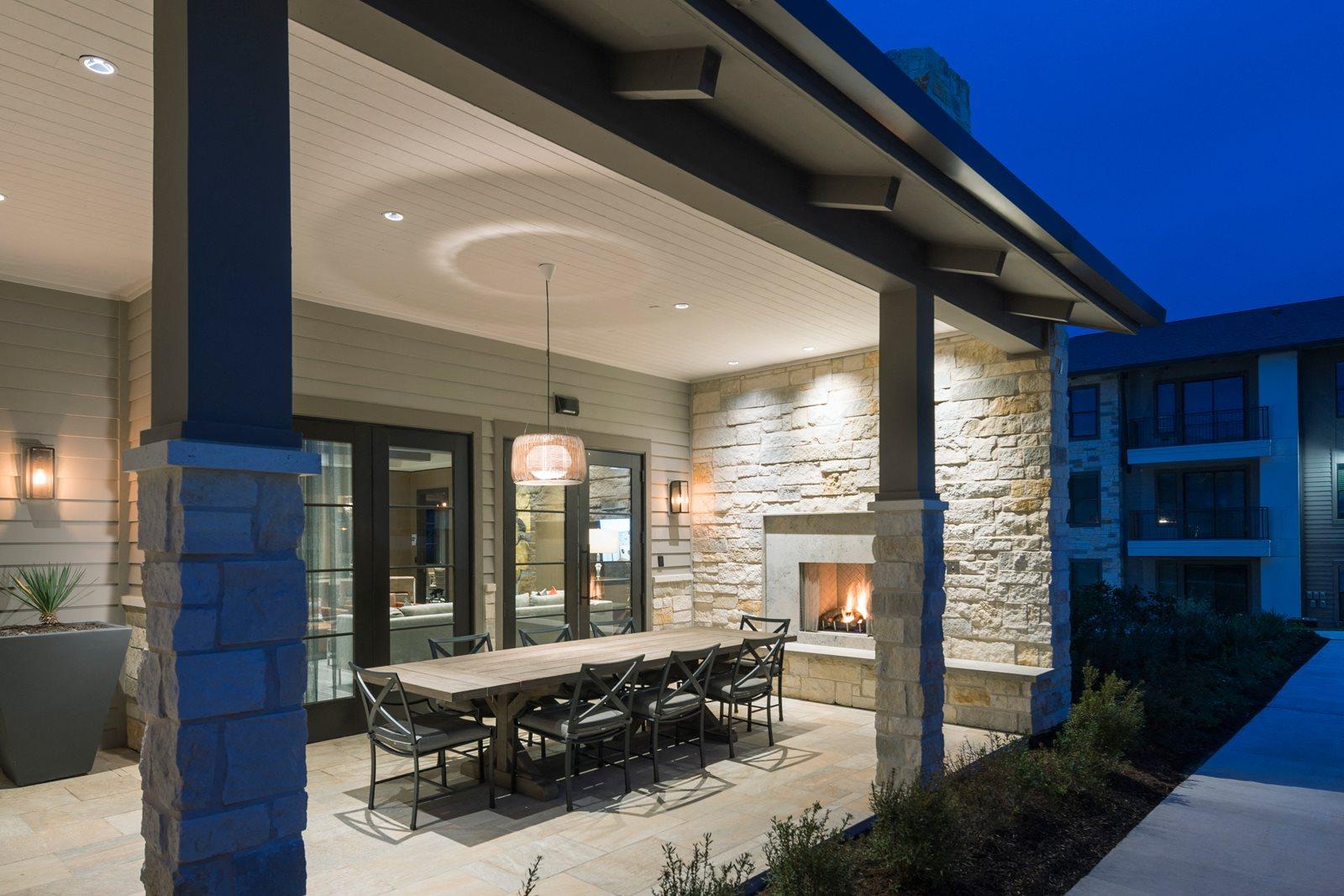 Open-Air Dining Porch with Fireplace at Windsor Lantana Hills, Austin, TX