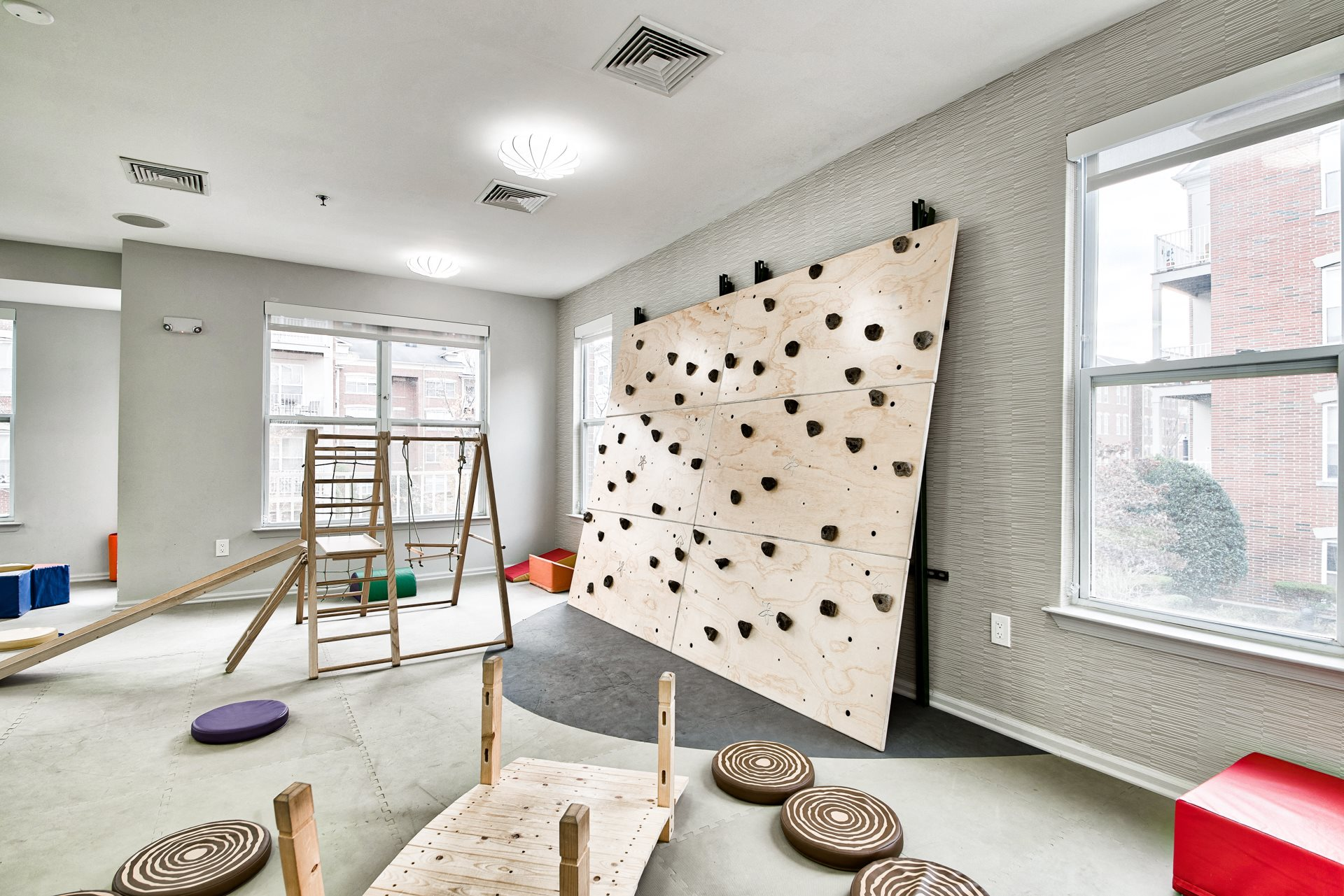 Children's playroom rock wall climbing at Liberty House by Windsor in Jersey City, NJ