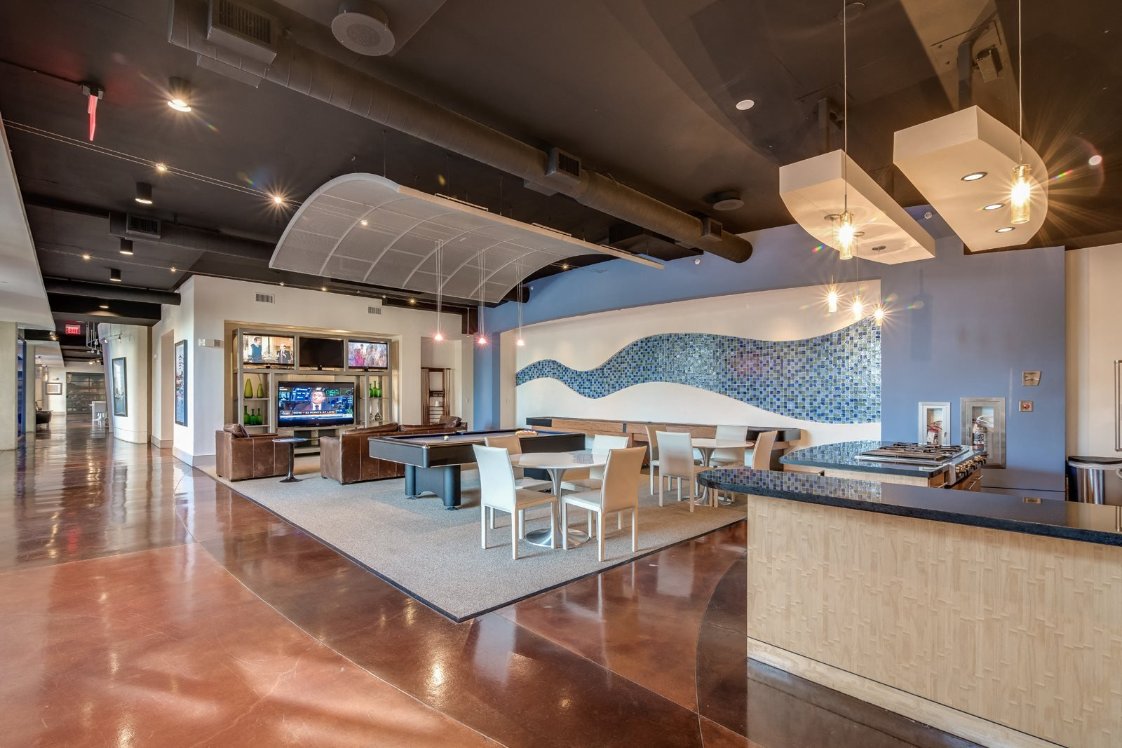Resident Lounge with Billiards and Shuffleboard Tables at Crescent at Fells Point by Windsor, 21231, MD