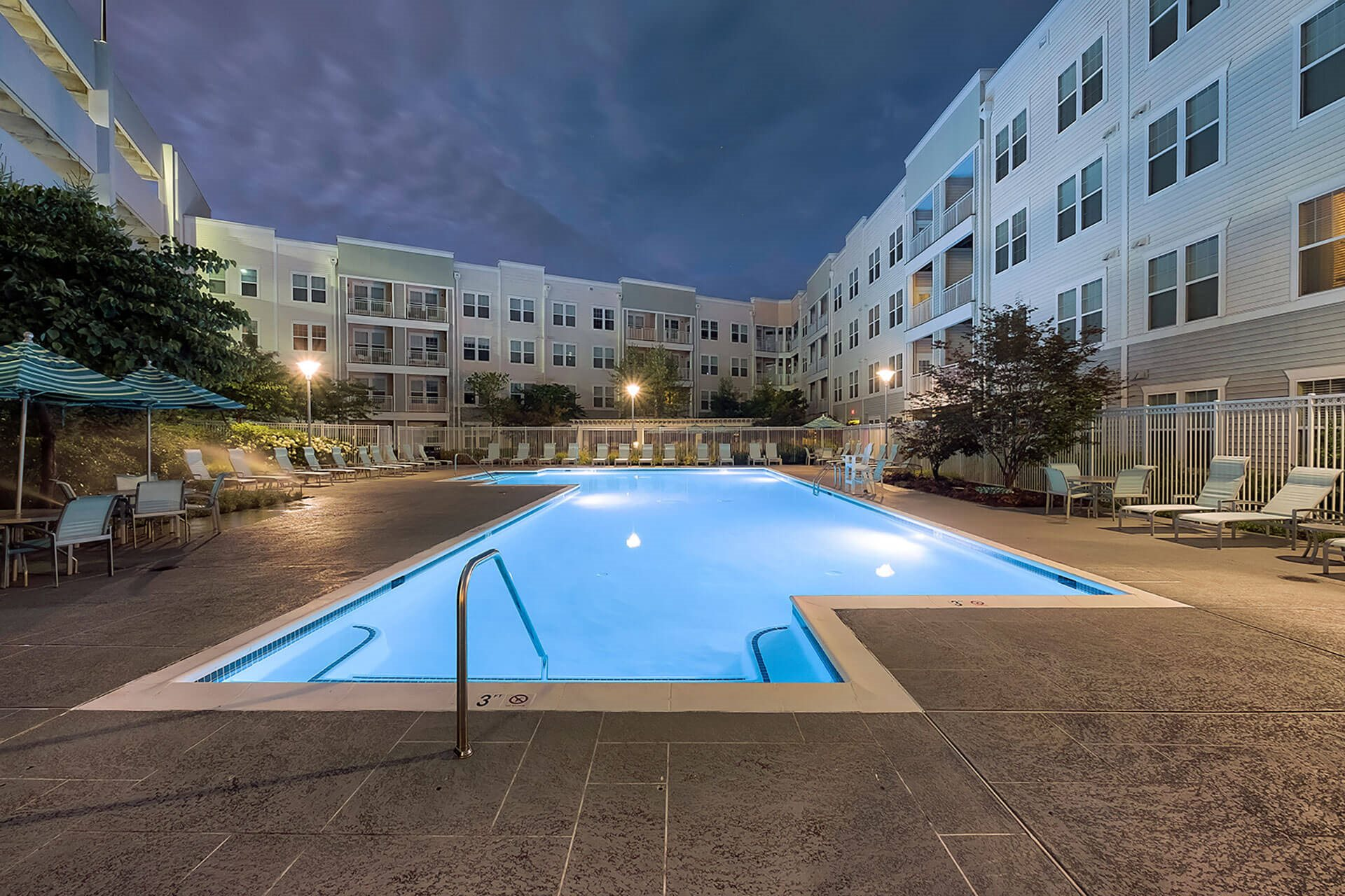 Lighted Pool at Night at The Ridgewood by Windsor, Fairfax, Virginia