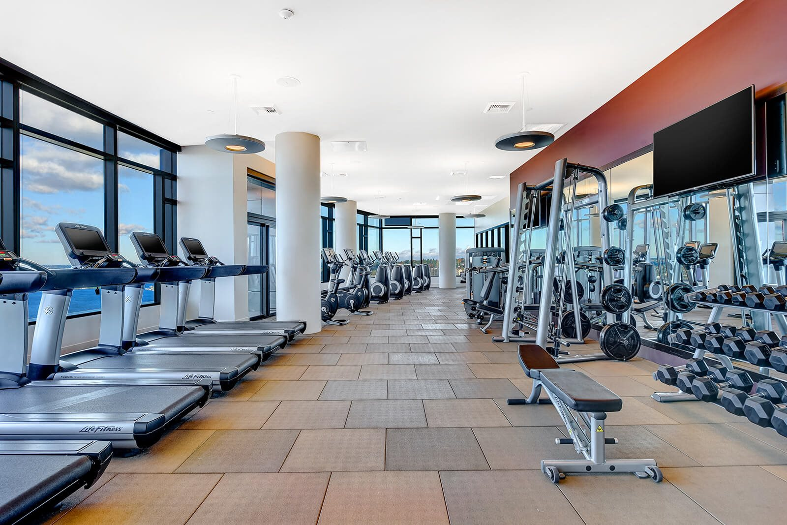 Fitness Center With Panoramic Views of Downtown at Cirrus, Seattle, WA