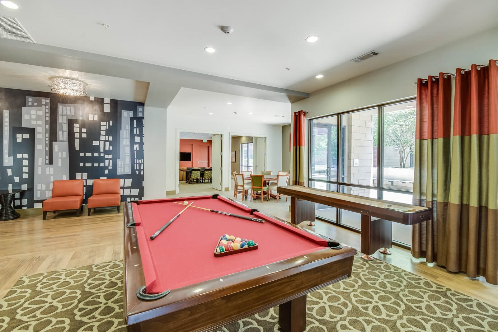 Game Room with Billiards Table at The Manhattan Tower and Lofts, Denver, CO