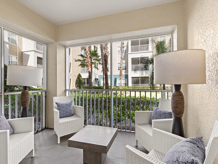 Living Space Extended To Screened Balcony at Savannah at Park Central, Orlando, Florida