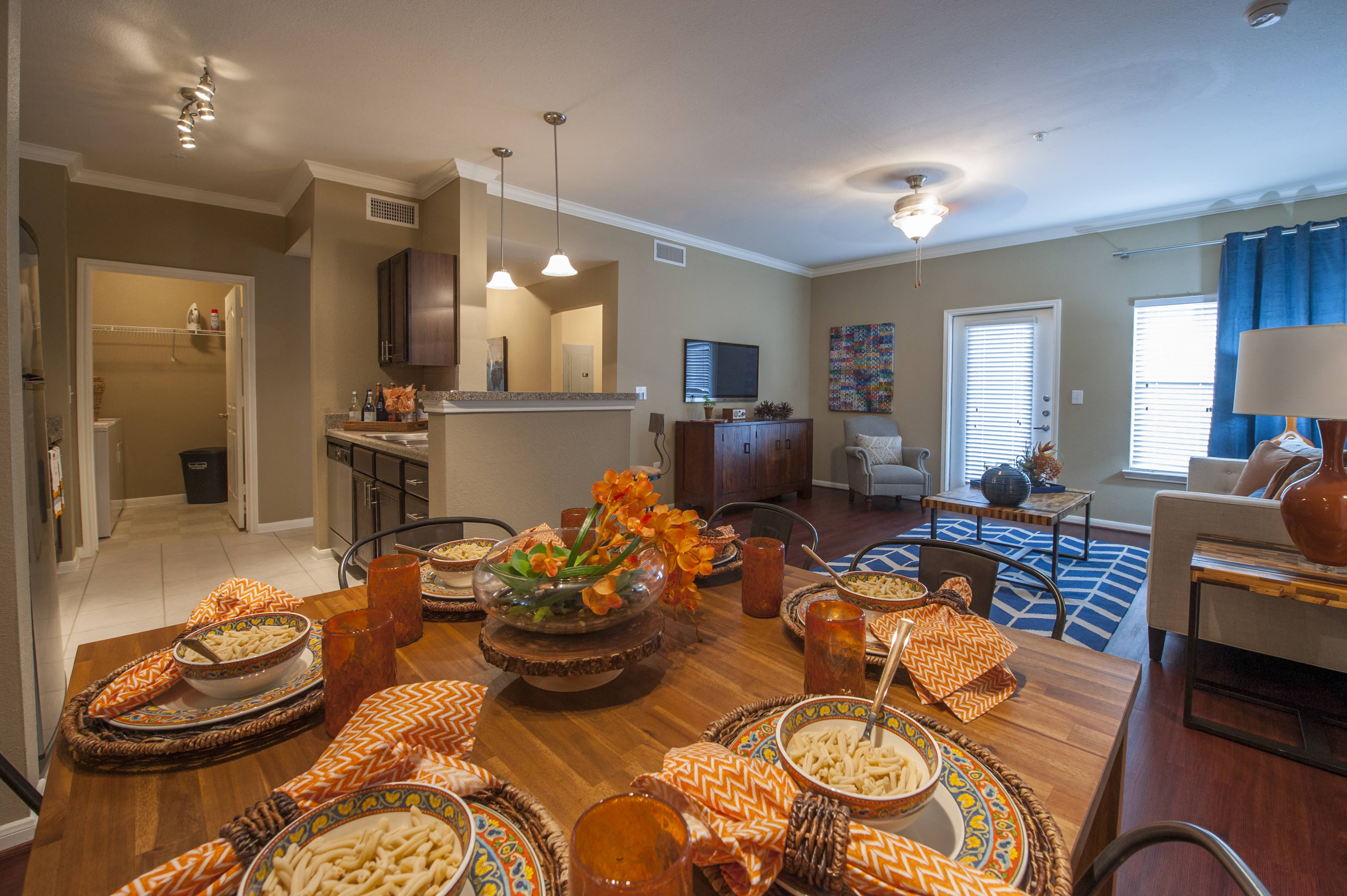 Bright living and dining space at Century South Shore, League City, TX