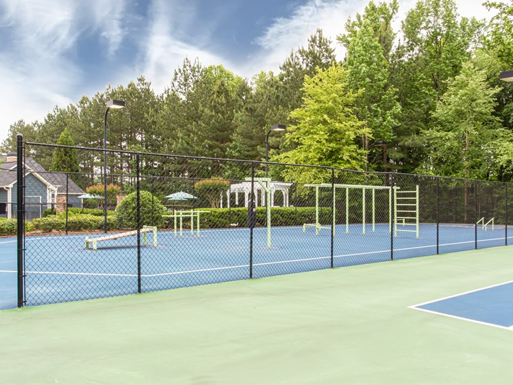 Brodick Hills tennis court with pool