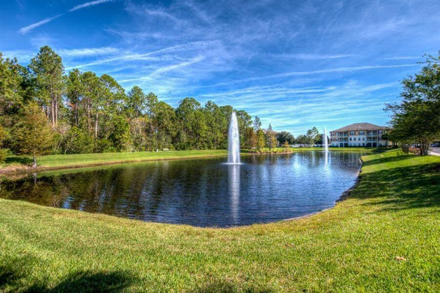 Large Lake with Fountains and Trail Including Outdoor Exercise Equipment